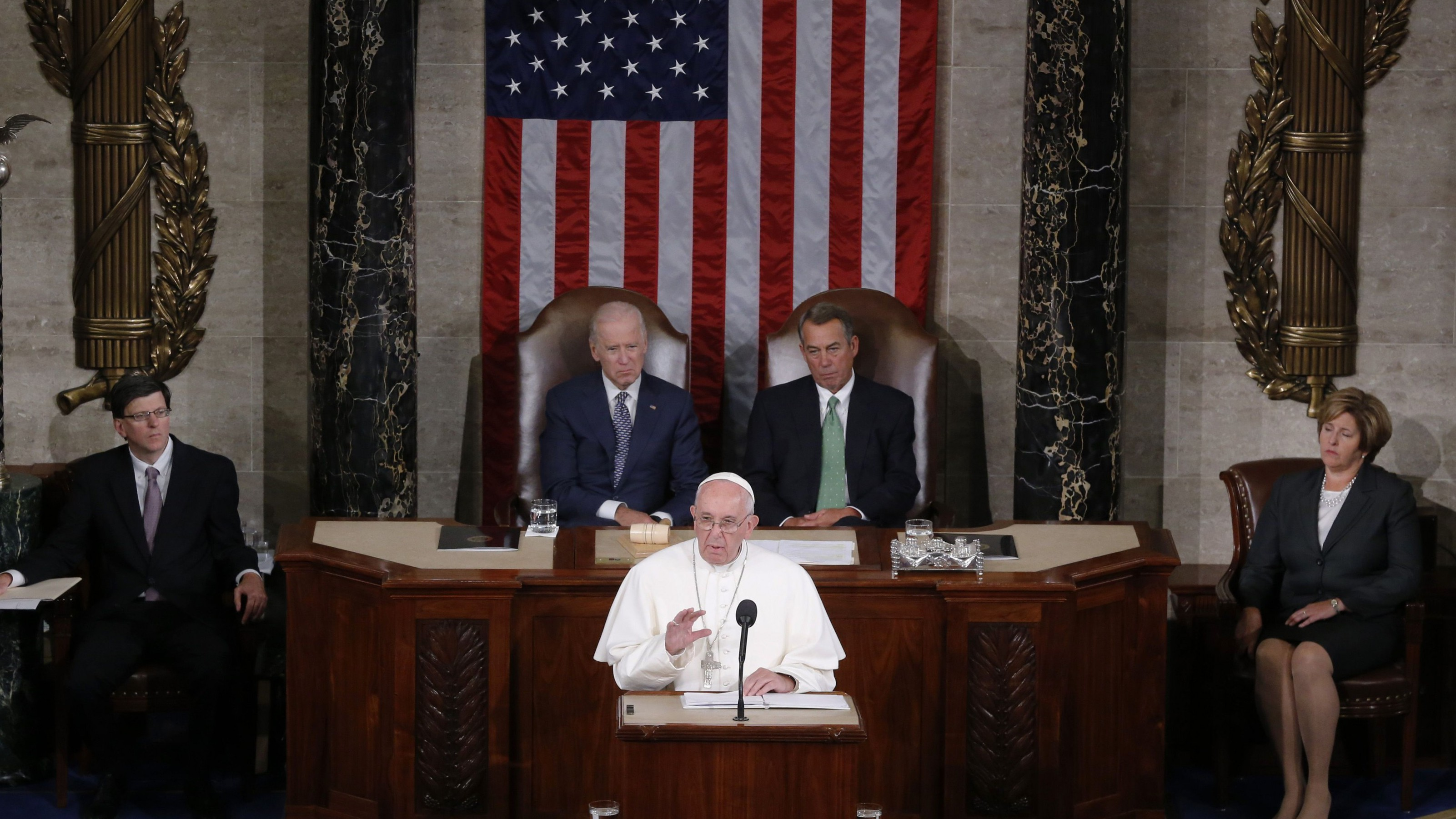 Pope Francis (C) addresses a joint meeting of the U.S. Congress as Vice President Joe Biden (L) and Speaker of the House John Boehner (R) look on in the House of Representatives Chamber on Capitol Hill in Washington September 24, 2015. REUTERS/Jim Bourg - RTX1S9FT