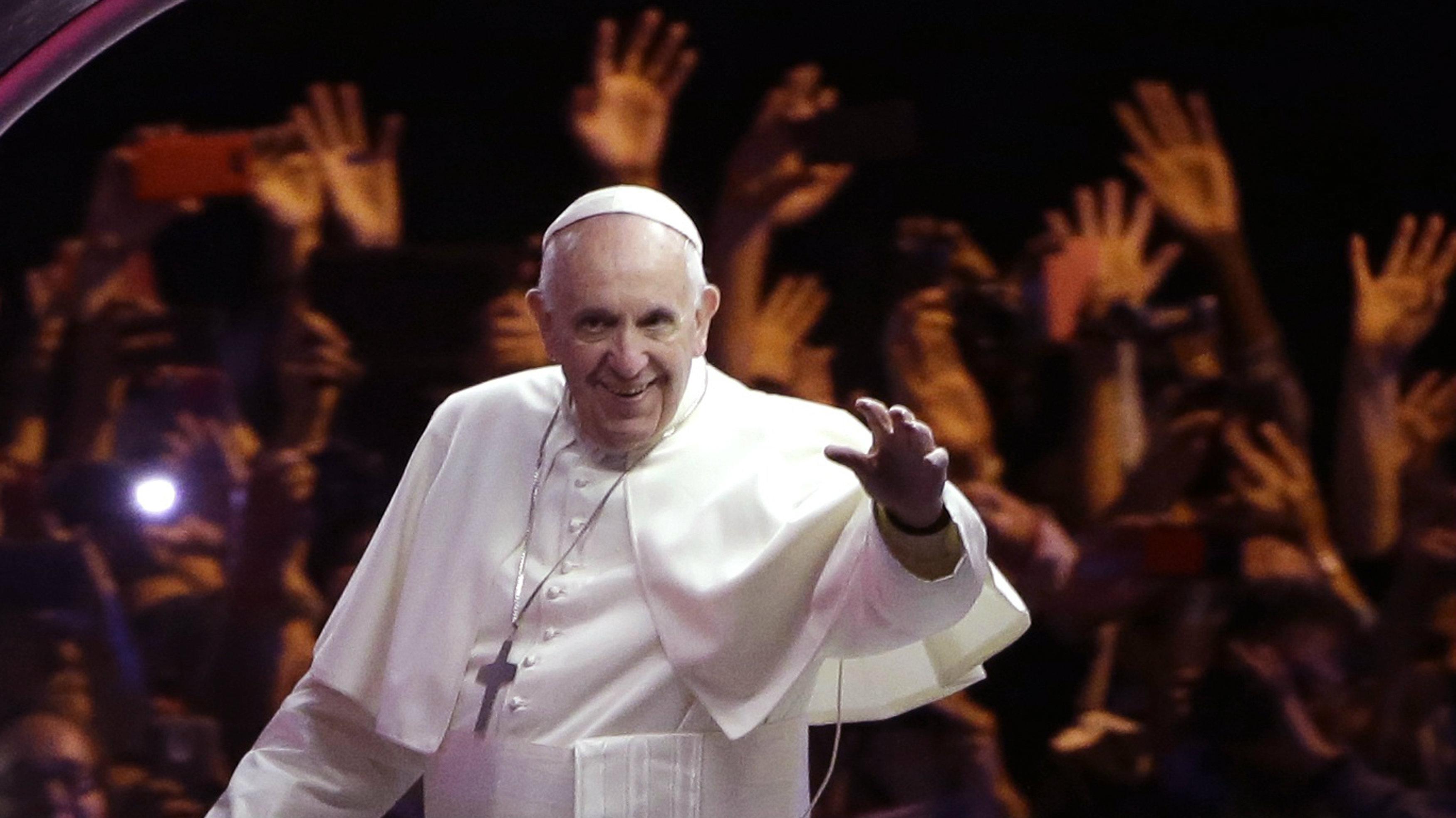 Pope Francis waves from his popemobile in Philadelphia September 26, 2015.