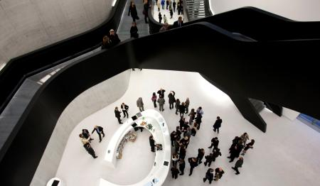 Guests walk inside Maxxi museum of contemporary art and architecture in Rome