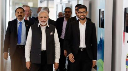 Prime Minister of India Narendra Modi, center, walks the hallways of Google headquarters alongside Google executive Sundar Pichai, at right, Sunday, Sept. 27, 2015, in Mountain View , Calif. After meeting with Facebook CEO Mark Zuckerberg at Facebook headquarters earlier, Modi scheduled meetings with the CEOs of Apple and Google during his whirlwind tour of Silicon Valley. (AP Photo/Marcio Jose Sanchez)