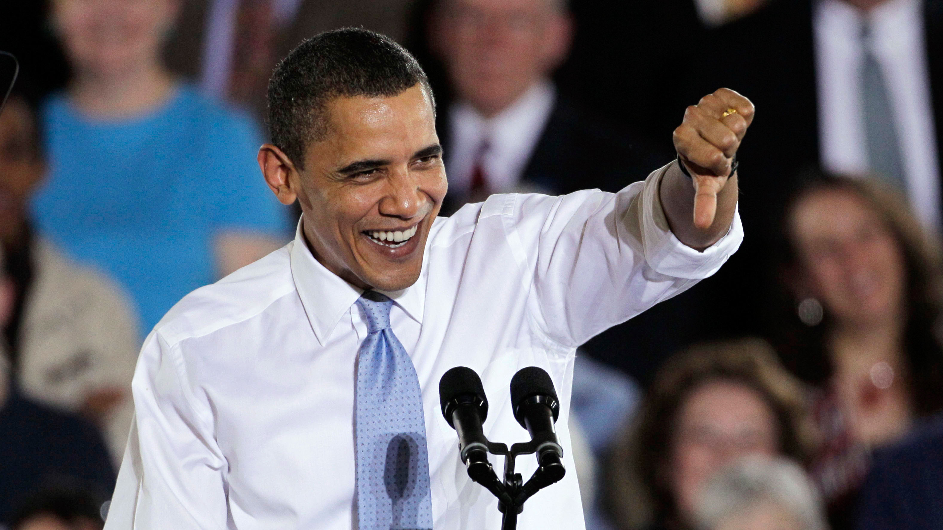 President Barack Obama gives a thumbs-down gesture while speaking on health insurance reform Thursday, April 1, 2010, at the Portland Expo in Portland, Maine.