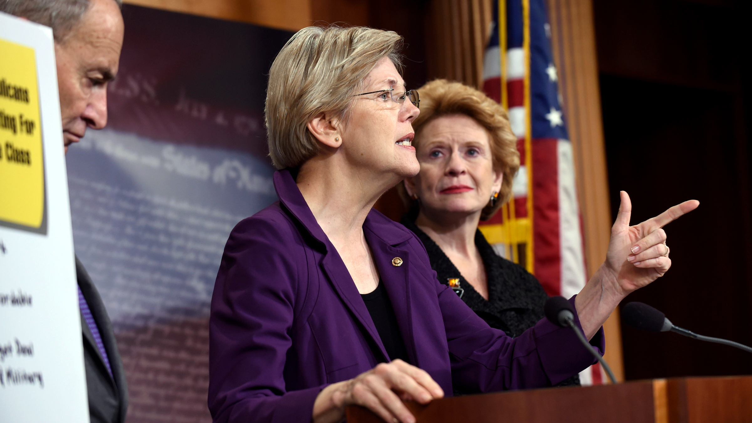 Sen. Elizabeth Warren, D-Mass., center, flanked by Sen. Charles Schumer, D-N.Y., left, and Sen. Debbie Sabenow, D-Mich., right, speaks to reporters on Capitol Hill in Washington, Thursday, July 30, 2015.