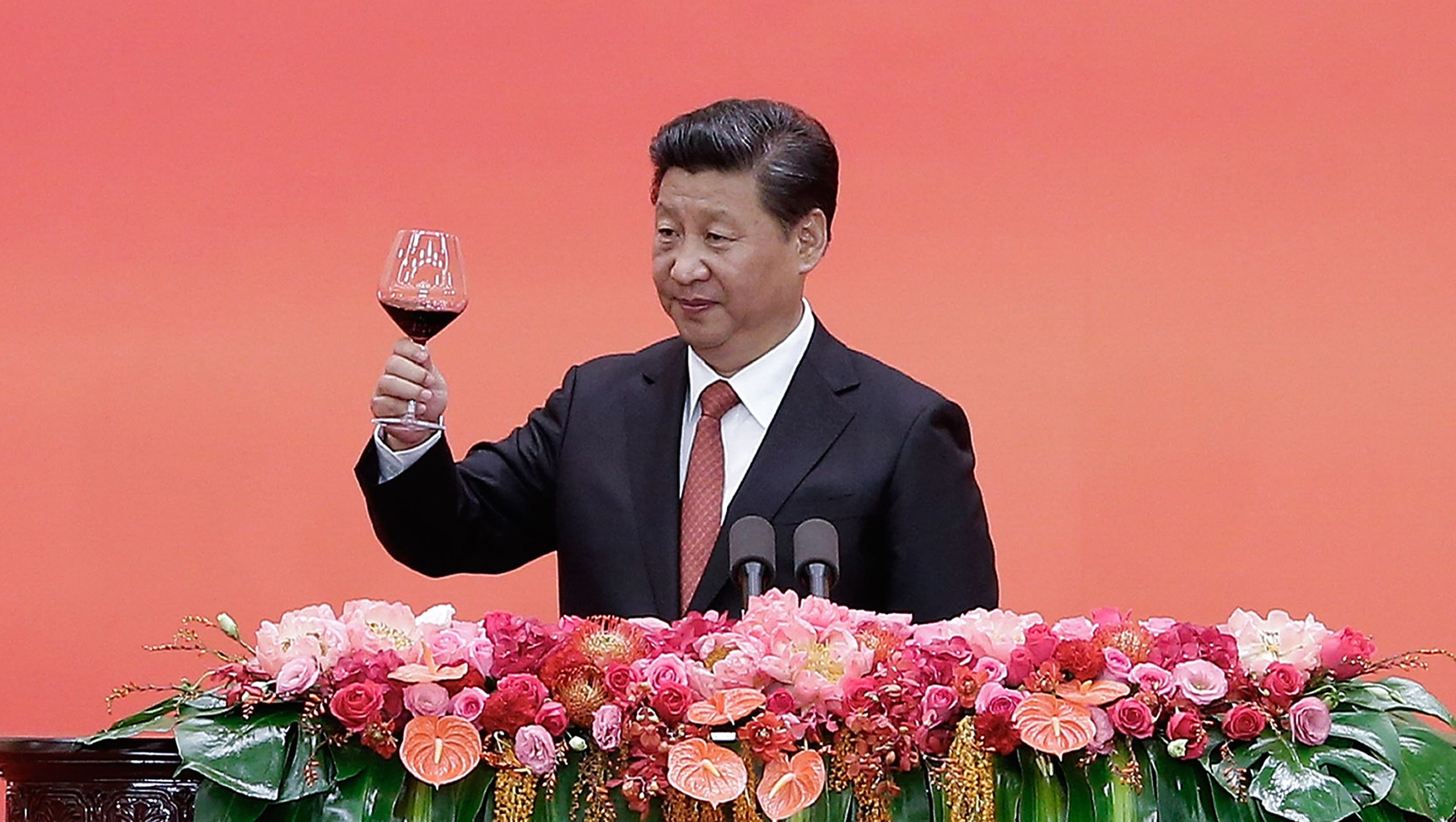 Chinese President Xi Jinping offers a toast after delivering a speech during a reception to mark the 70th anniversary of Japan's surrender during World War II in Beijing, Thursday, Sept. 3, 2015. (Lintao Zhang