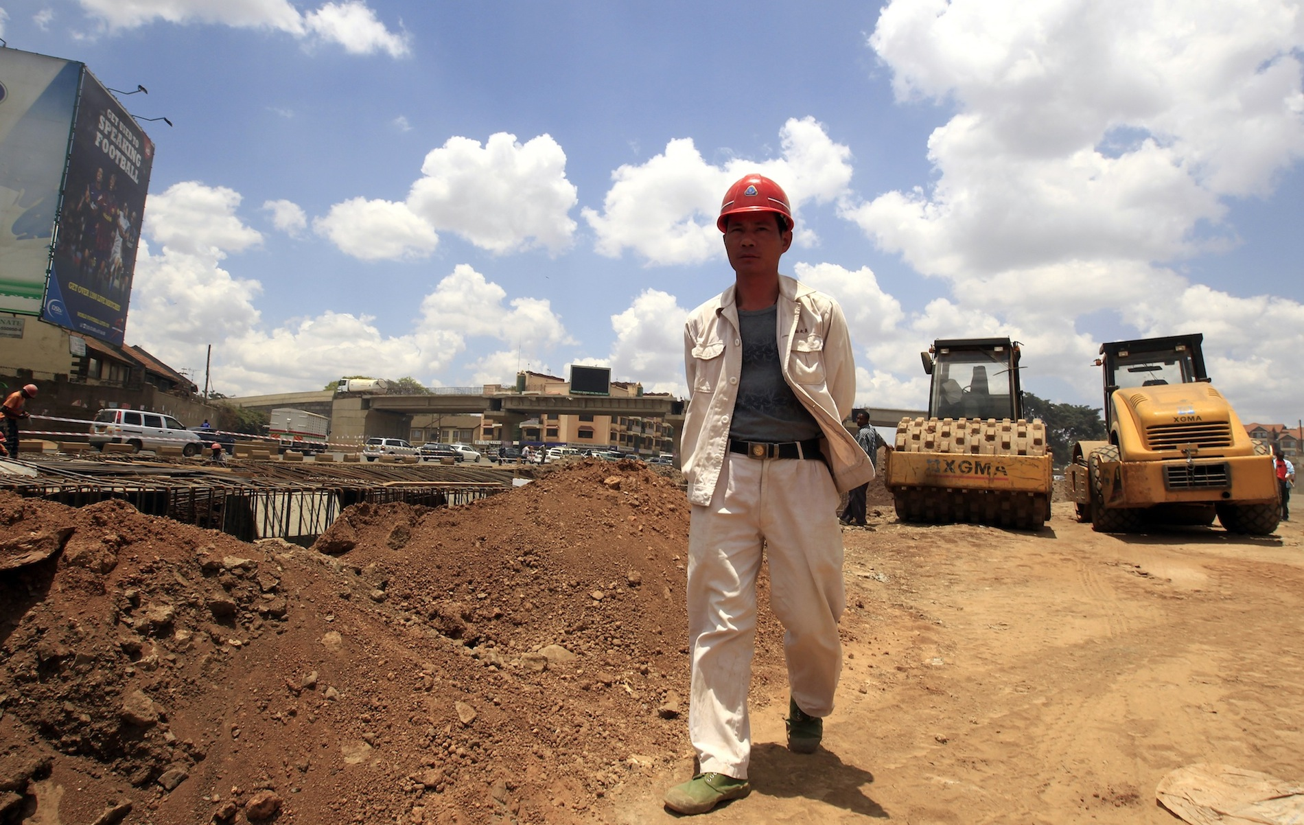 A Chinese contractor walks at the site of the Nairobi-Thika highway project near Kenya's capital Nairobi.