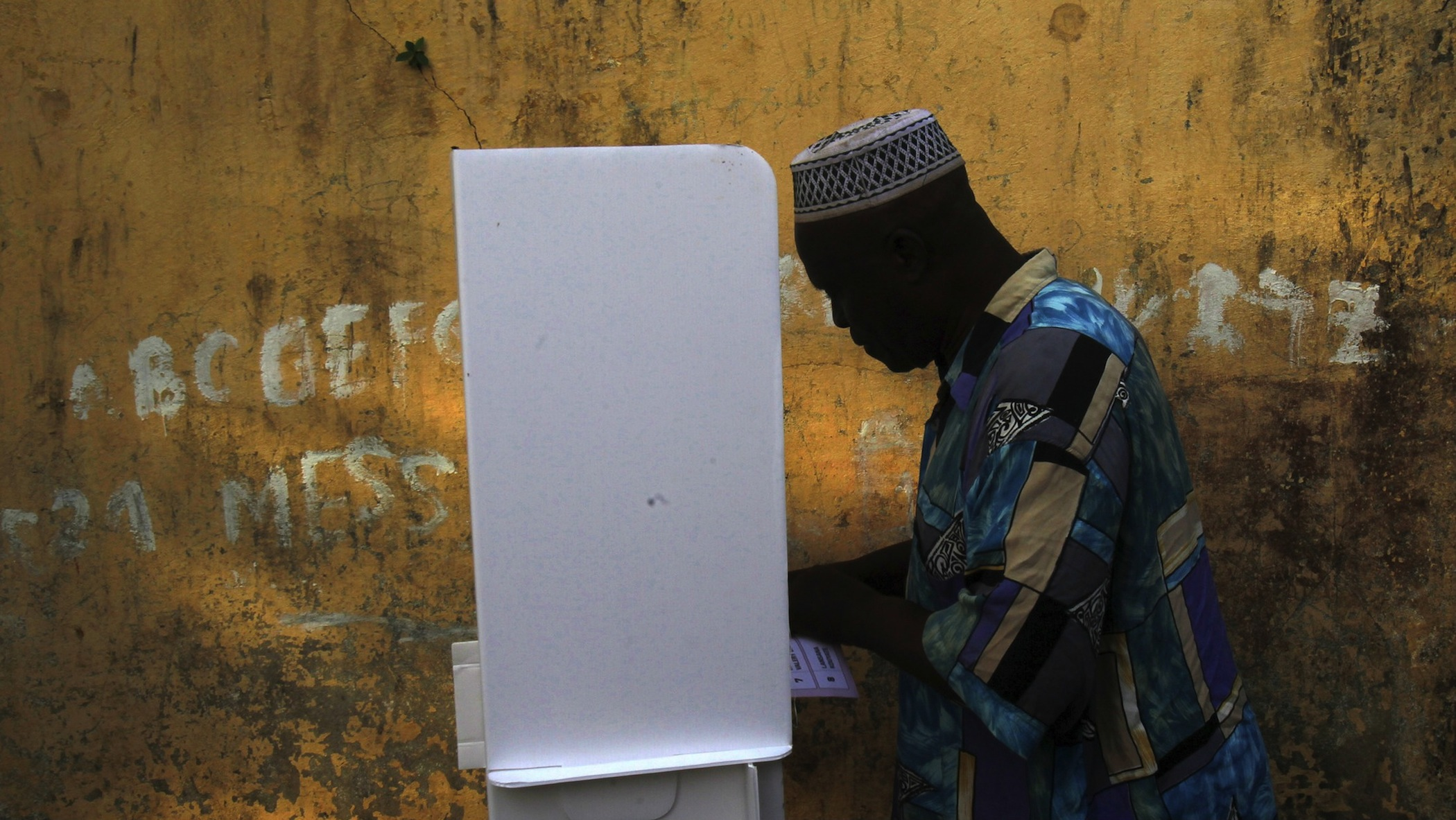 A man casts his vote at a polling station during a presidential election in Conakry, Guinea