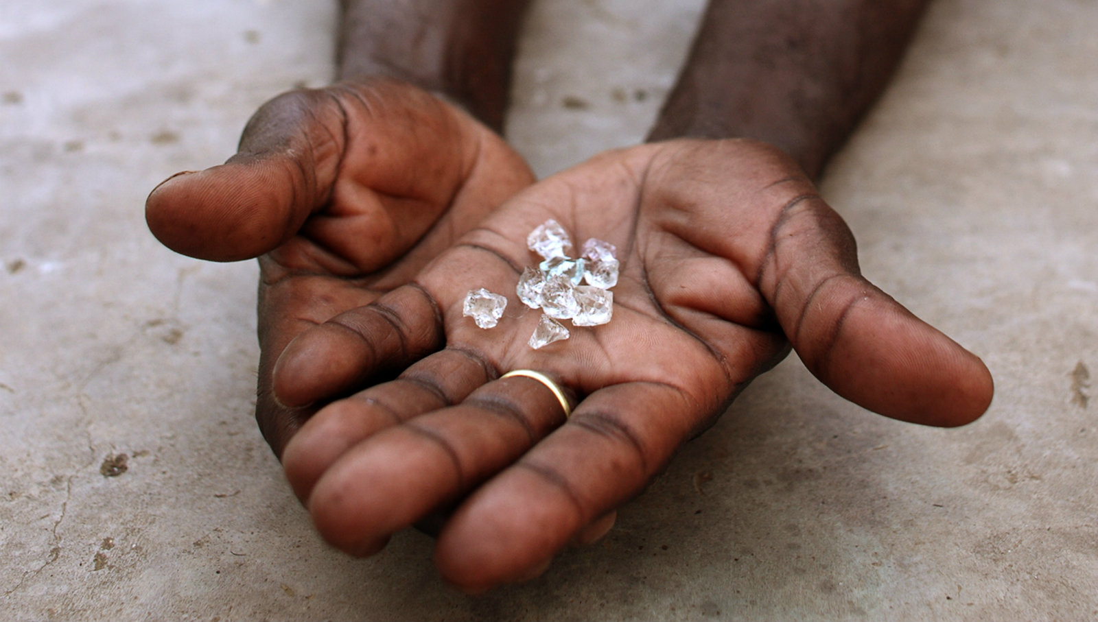 An illegal diamond dealer from Zimbabwe displays diamonds for sale in Manica, near the border with Zimbabwe, September 19, 2010. World Diamond Council president Eli Izhakoff said recently the flow of illicit diamonds was now less than 0.2 percent of global volumes.