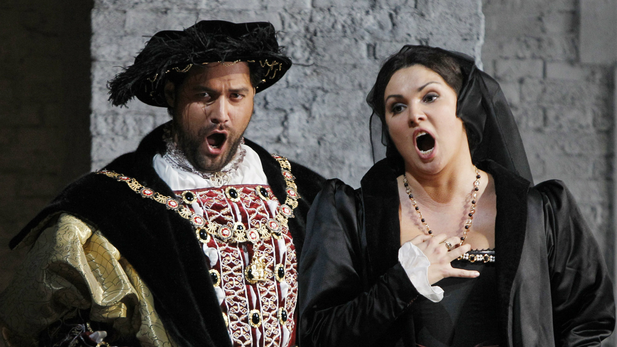 "In this Sept. 22, 2011, photo, Bass Ildar Abdrazakov, left, portrays Henry VIII, King of England, with co-star soprano Anna Netrebko as Anne Boleyn during the final full dress rehearsal for Gaetano Donizetti's ""Anna Bolena,"" at the Metropolitan Opera in New York."