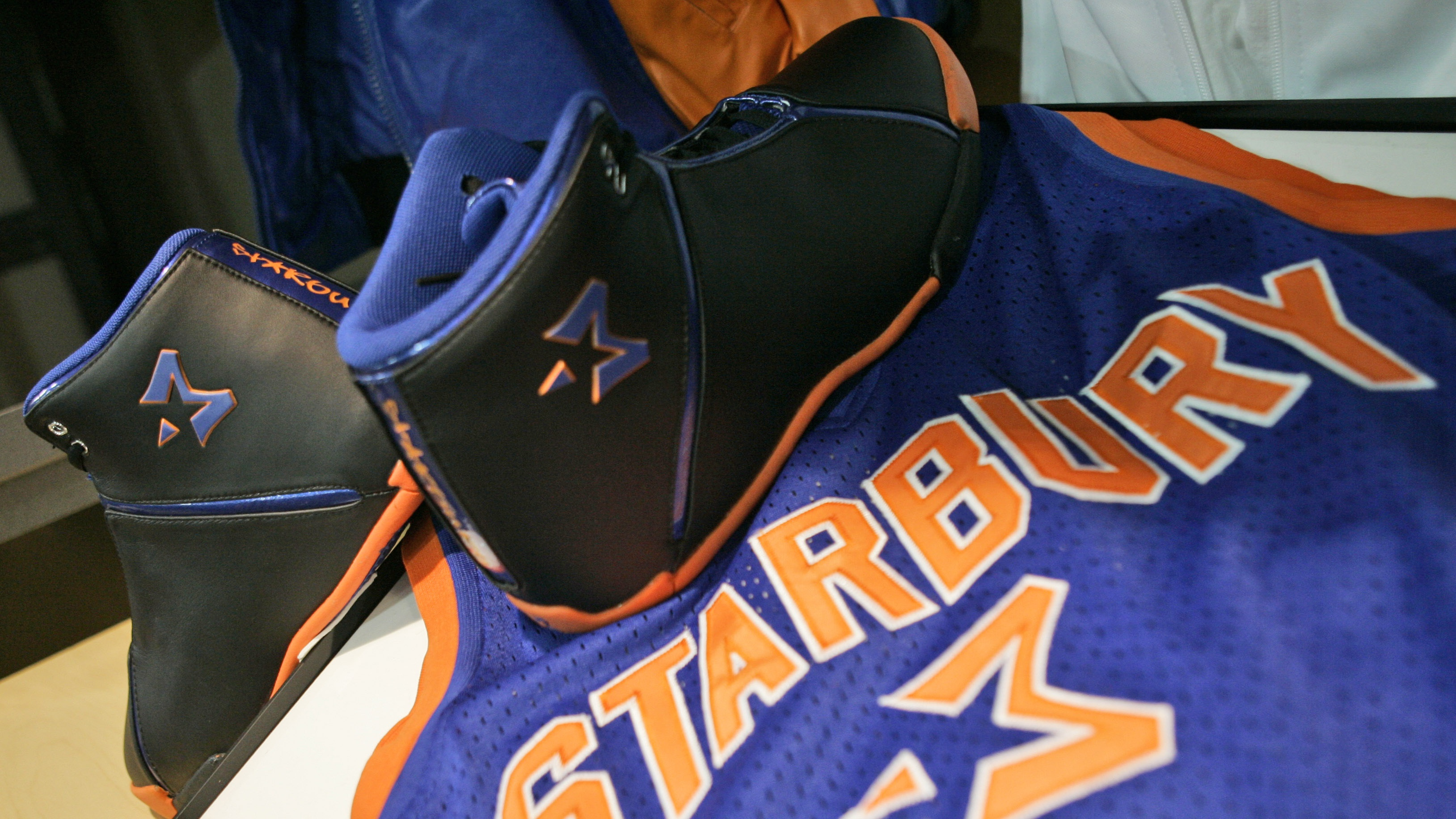 A pair of Starbury One high performance sneakers and a Starbury jersey are on display during a news conference Friday, Dec. 8, 2006 in New York.
