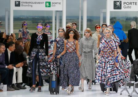Models wear creations for Chanel's Spring-Summer 2016 ready-to-wear fashion collection presented during the Paris Fashion Week, Tuesday, Oct. 6, 2015 in Paris, France. (AP Photo/Francois Mori)