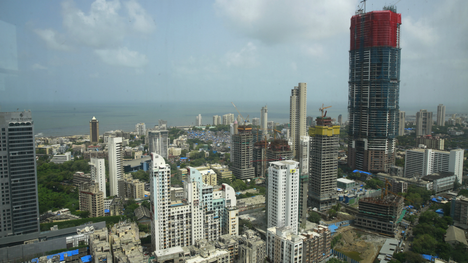 High rises now occupy the prime real estate that once housed the city's textile mills a few decades ago in Mumbai, Wednesday, July 15, 2015.