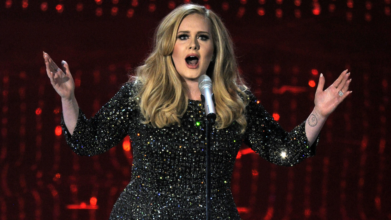 """FILE - In this Feb. 24, 2013 file photo, singer Adele performs during the Oscars at the Dolby Theatre in Los Angeles. Adele's """"Hello"""" was released Friday, Oct. 23, 2015, and topped the iTunes singles chart in 85 countries. The music video broke the Vevo record for most views in a day with 27.7 million.  (Photo by Chris Pizzello/Invision/AP, File)"""