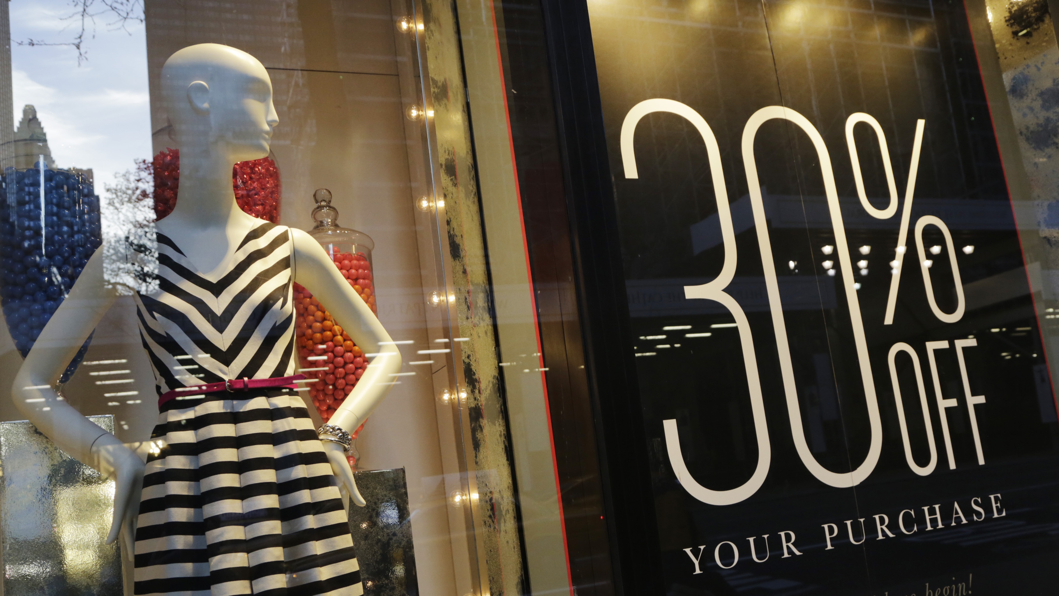 A 30 percent off sign is displayed in a Banana Republic store, Wednesday, Nov. 20, 2013 in New York.