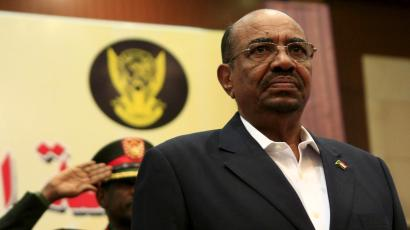 Sudan's President Omar al-Bashir listen to the National anthem during opening session of Sudan National Dialogue conference October 10, 2015.
