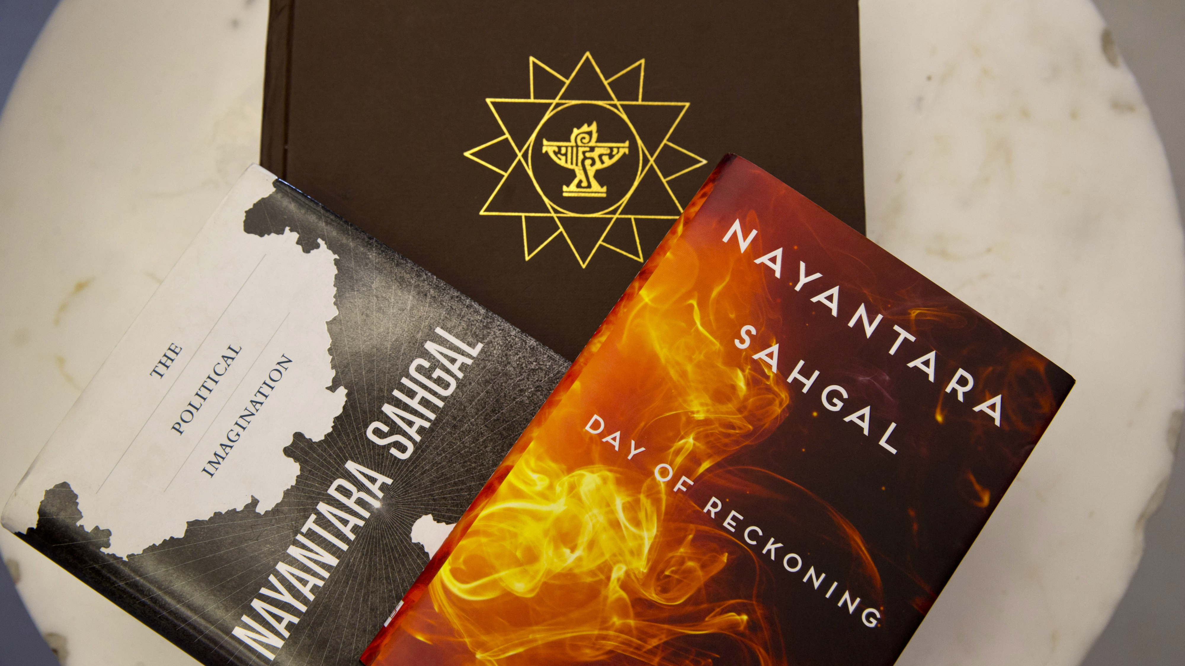Books by Indian writer Nayantara Sahgal are arranged for illustration purpose at a bookstore in New Delhi, India, Wednesday, Oct. 14, 2015. Dozens of writers, including Sahgal, have returned India's highest literary honor to protest what they call a growing climate of intolerance in the country since Prime Minister Narendra Modi's government took office. (AP Photo/Saurabh Das)