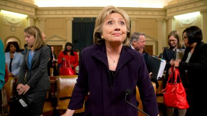 Democratic presidential candidate and former Secretary of State Hillary Rodham Clinton stands up at the end of testimony on Capitol Hill in Washington, Thursday, Oct. 22, 2015, before the House Select Committee on Benghazi.