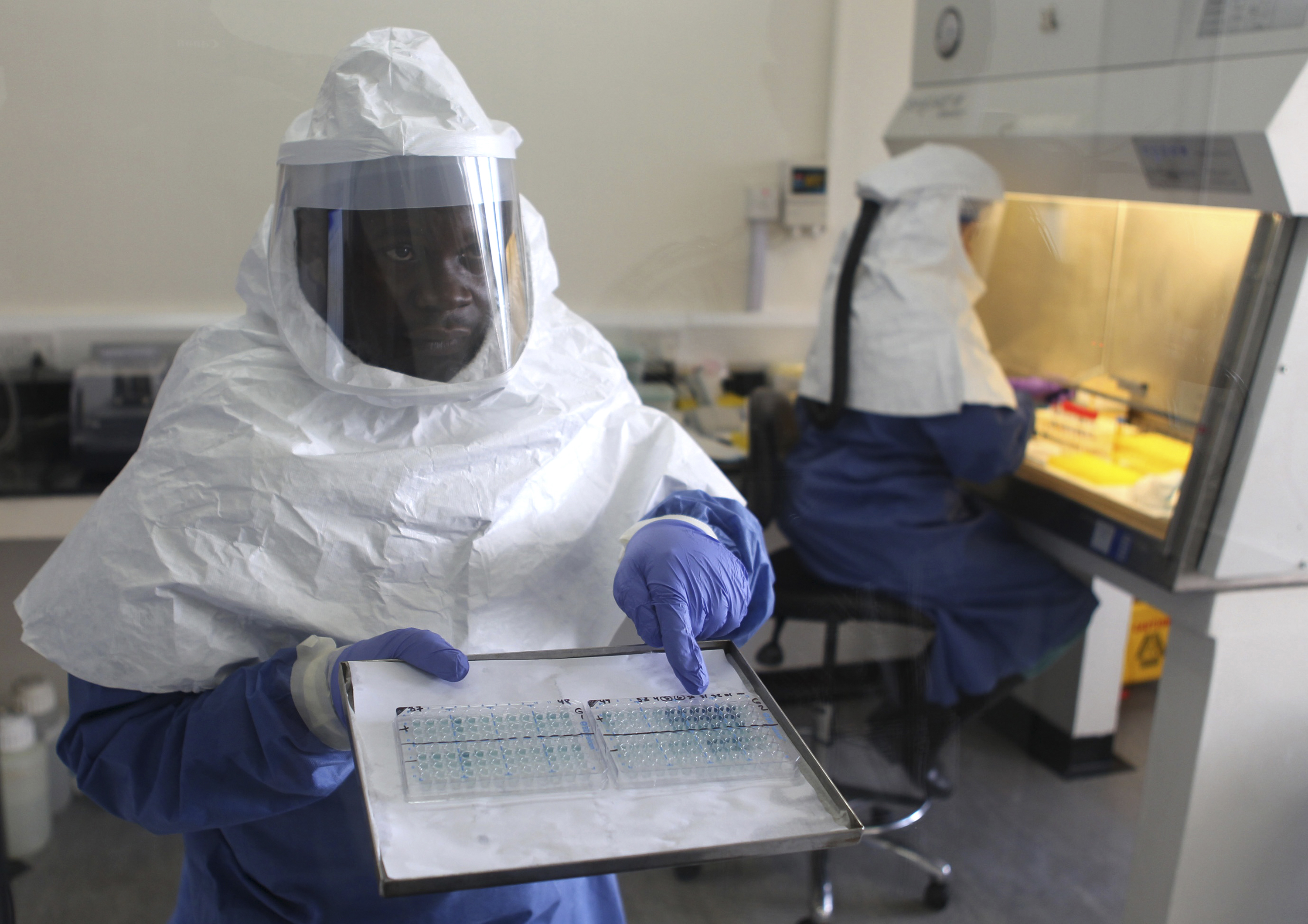 A doctor displays collected samples of the Ebola virus at the Centre for Disease Control in Entebbe, about 37km (23 miles) southwest of Uganda's capital Kampala, August 2, 2012.