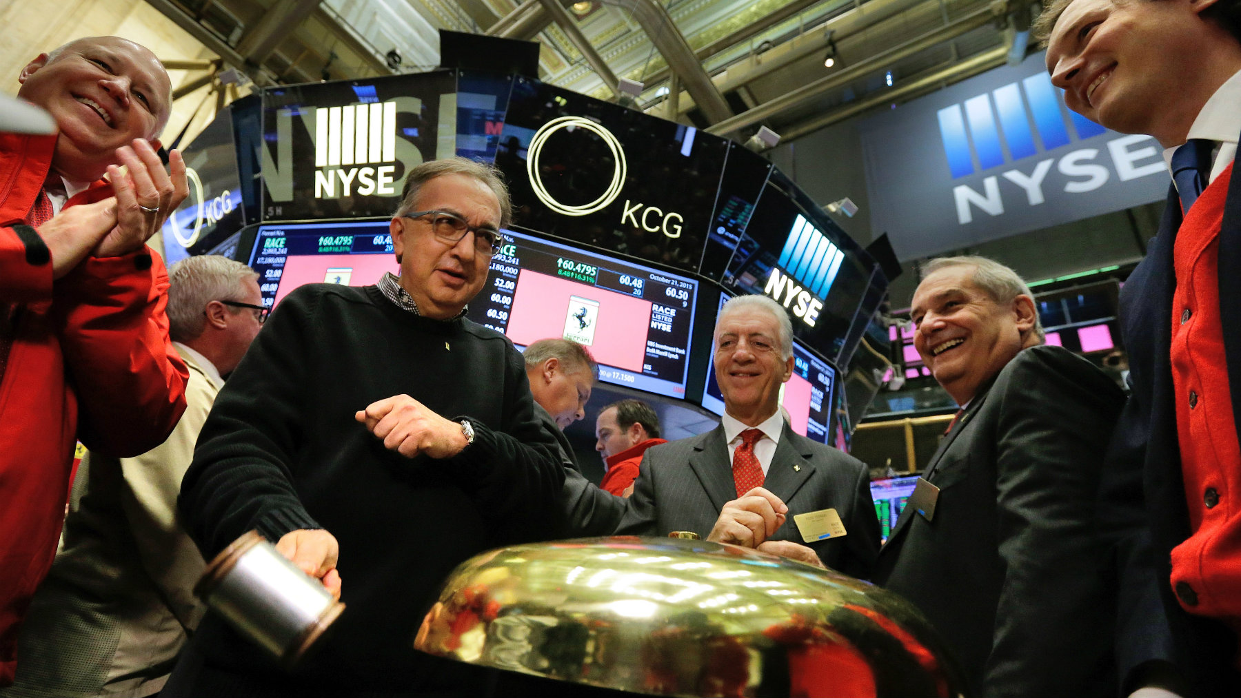 From second left, Fiat Chrysler CEO Sergio Marchionne, Piero Ferrari, son of founder Enzo Ferrari, Ferrari CEO Amedeo Felisa, and Fiat Chrysler chairman John Elkann ring a ceremonial bell to open the New York Stock Exchange.