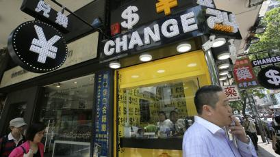 A man walks past a currency exchange shop in Hong Kong.