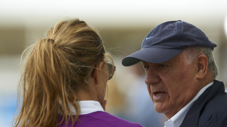 Amancio Ortega talks with his daughter Marta Ortega during day one of the Global Champions Tour 2011 at Ciudad de Las Artes y Las Ciencias on May 6, 2011 in Valencia, Spain.