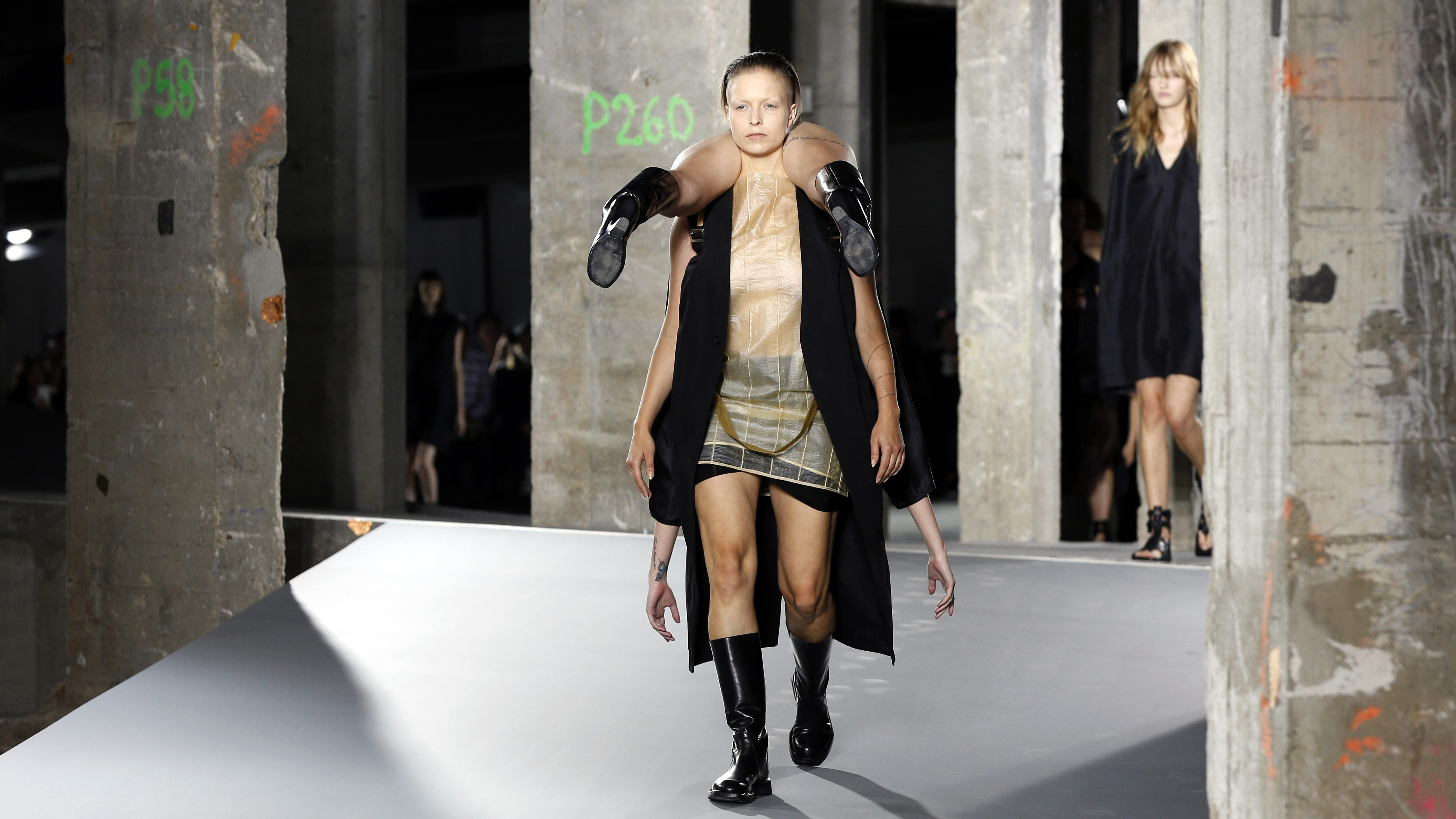 Models present creations by Rick Owens during the 2016 Spring/Summer ready-to-wear collection fashion show, on October 1, 2015 in Paris.
