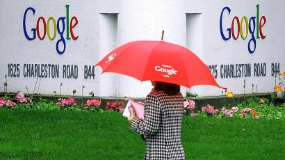 A woman walks past a street sign for Google in Mountain View, Calif., Monday, Jan. 30, 2006. Online search engine leader Google Inc. is expected to report more staggering financial growth after the stock market closes, but even a stellar fourth-quarter earnings report might not be enough to propel its high-flying stock. (AP Photo/Jeff Chiu)