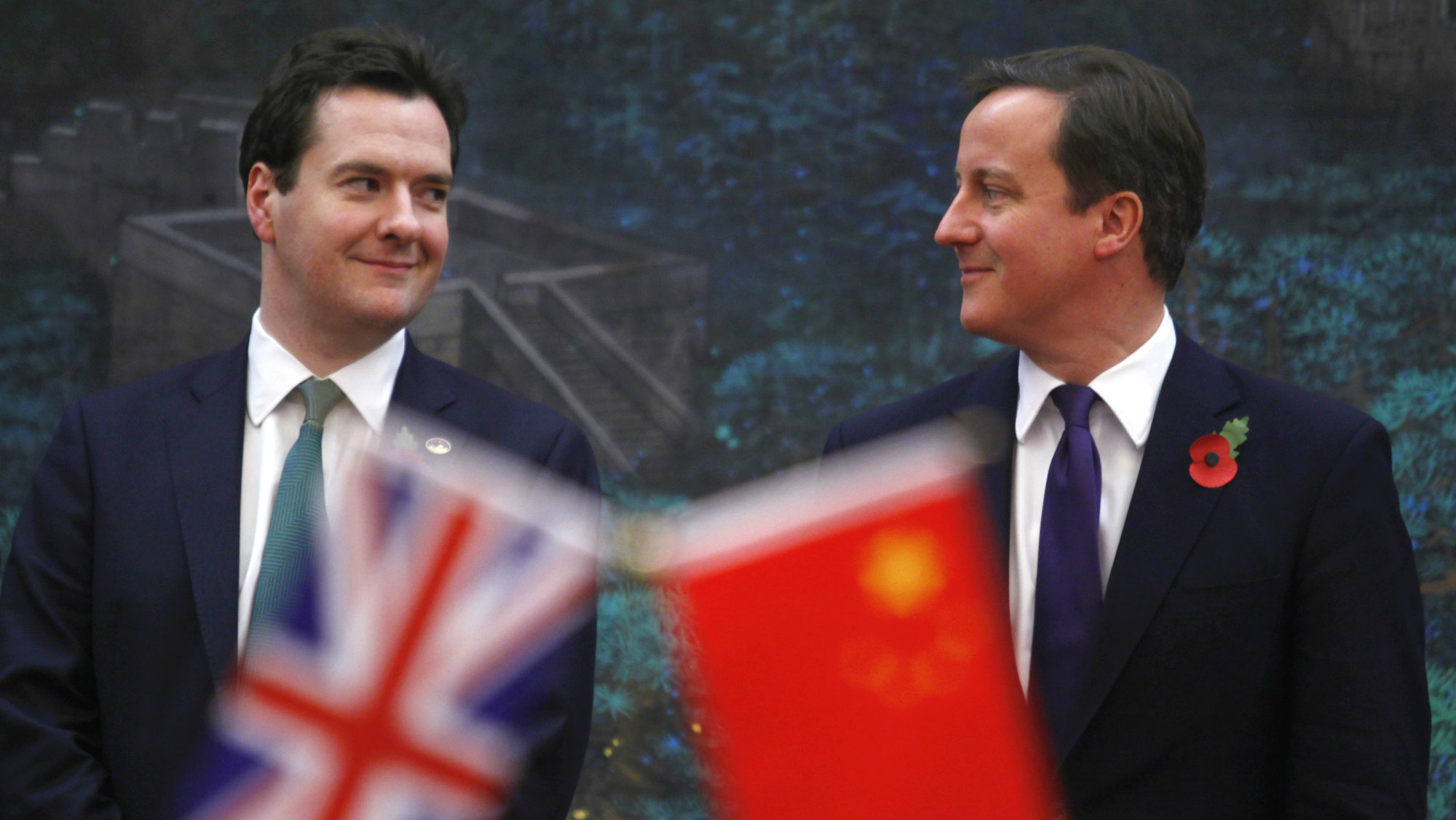 Britain's Prime Minister David Cameron (R) and Britain's Chancellor of the Exchequer George Osborne attend a signing ceremony with China's Premier Wen Jiabao (not pictured) at the Great Hall of the People in Beijing, China, 09 November 2010.