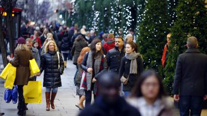Christmas shoppers walk down Oxford Street in central London.