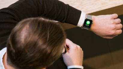 A man checks out Apple's new watch during a preview day at the Apple Store in Covent Garden in London.