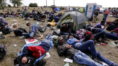 Refugees sleep as they wait on the entrance of a Registration camp at the Opatovac village near Tovarnik ,Croatia, 22 September 2015.