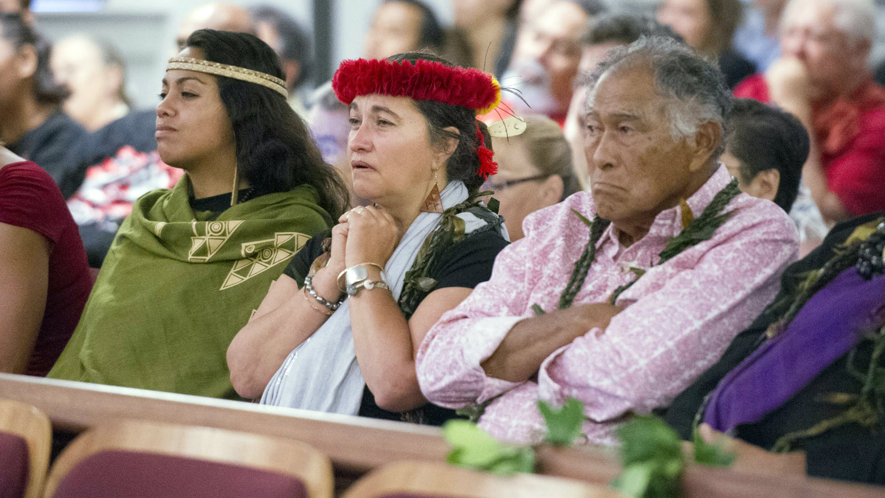 Haiwane Rios, left, Pua Case and Ku Ching pictured in the front row of the gallery as oral arguments over the TMT began at the Hawaii State Supreme Court in Honolulu, Hawaii.