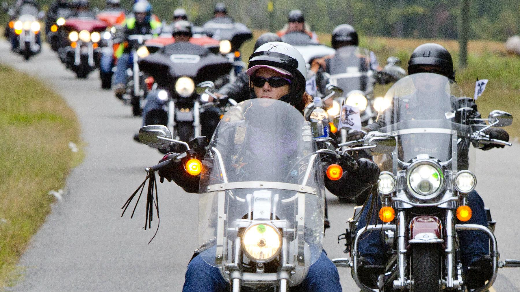 Riders participate in a Harley-Davidson service event.