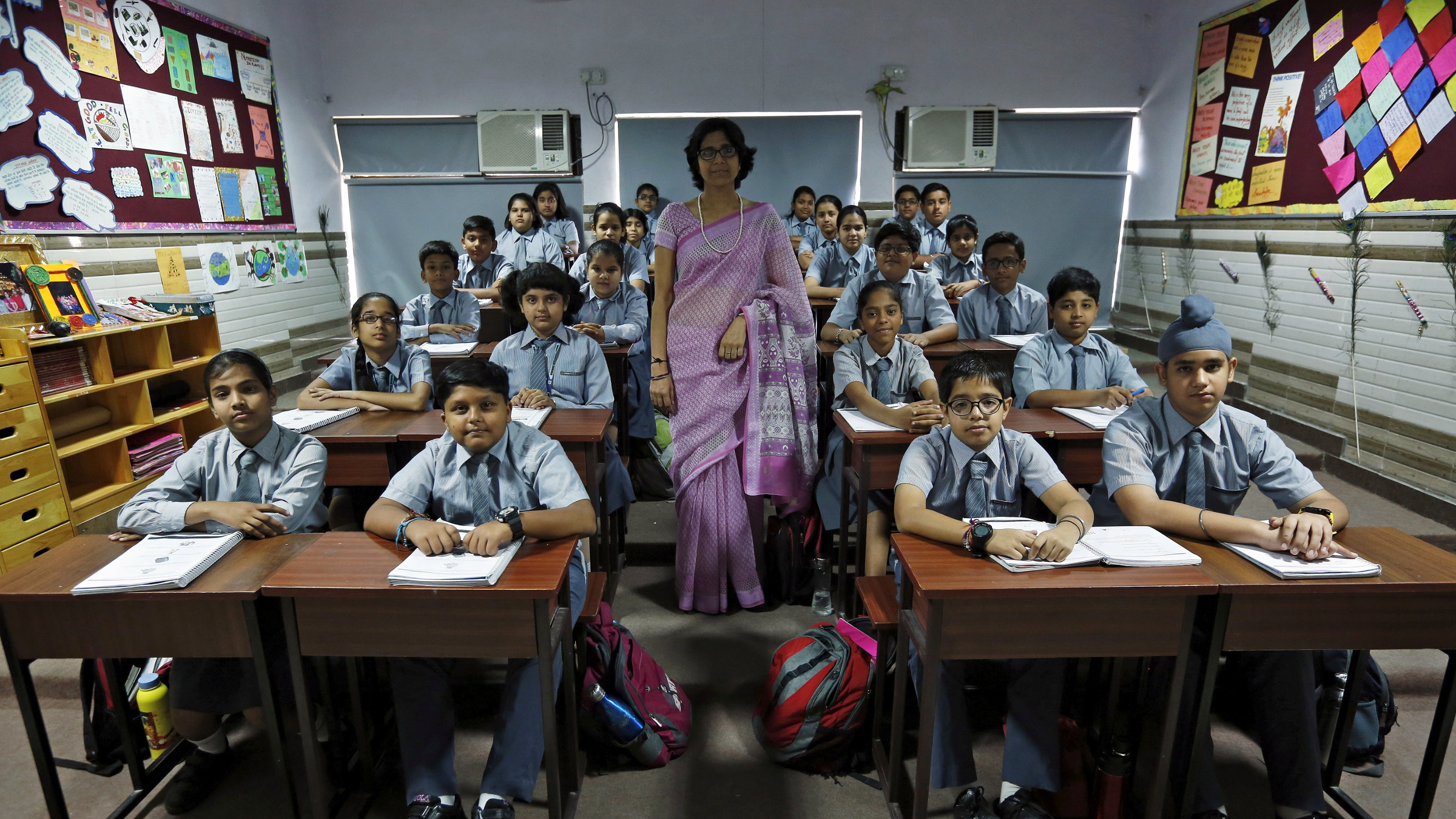 Teacher Archana Shori poses for a picture with 7th-grade level students inside their classroom at Rukmini Devi Public school in New Delhi, India, September 7, 2015. Nearly three years after Taliban gunmen shot Pakistani schoolgirl Malala Yousafzai, the teenage activist last week urged world leaders gathered in New York to help millions more children go to school. World Teachers' Day falls on 5 October, a Unesco initiative highlighting the work of educators struggling to teach children amid intimidation in Pakistan, conflict in Syria or poverty in Vietnam. Even so, there have been some improvements: the number of children not attending primary school has plummeted to an estimated 57 million worldwide in 2015, the U.N. says, down from 100 million 15 years ago. Reuters photographers have documented learning around the world, from well-resourced schools to pupils crammed into corridors in the Philippines, on boats in Brazil or in crowded classrooms in Burundi.