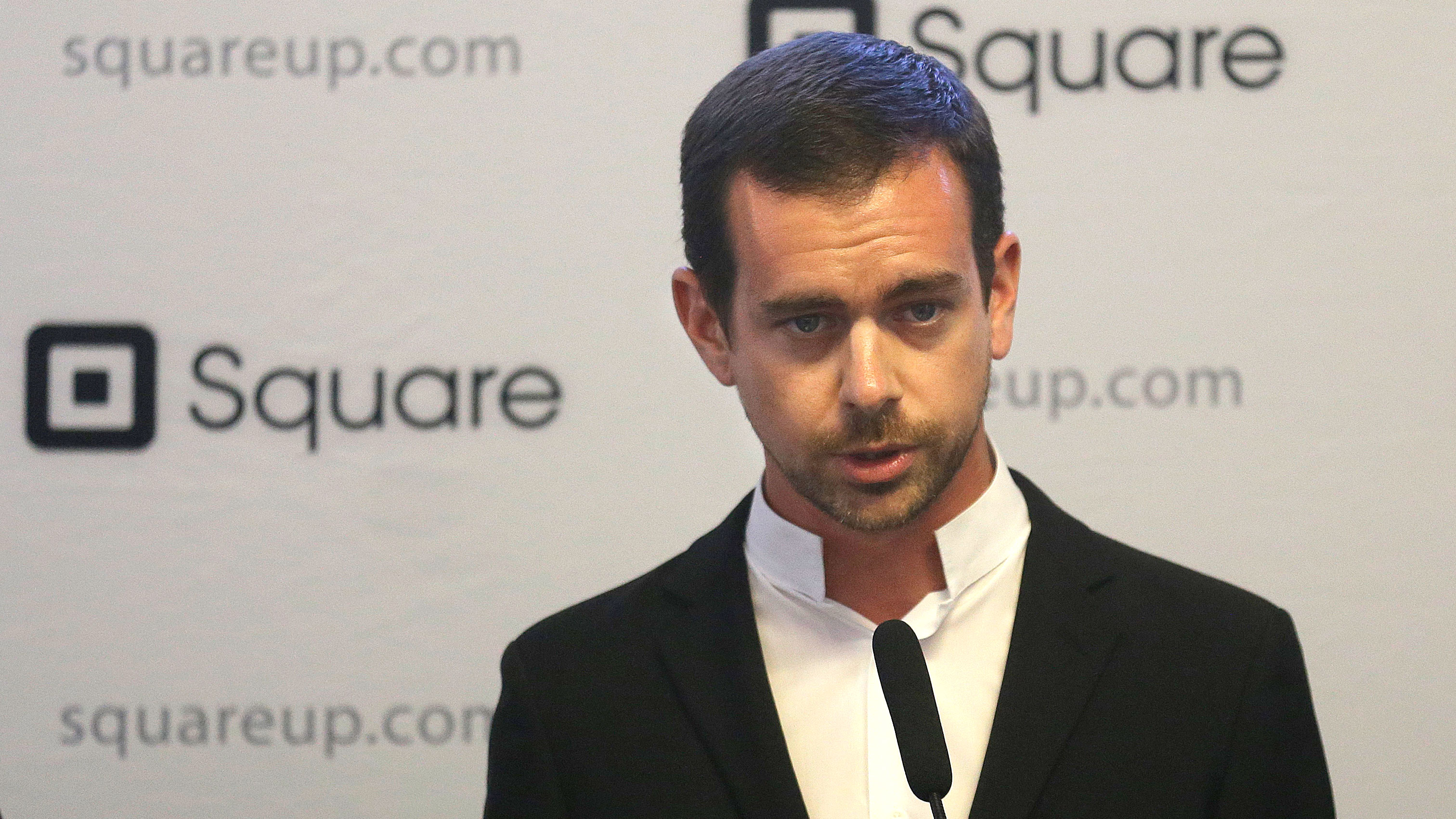 "Square CEO Jack Dorsey speaks at a news conference in San Francisco, Friday, June 14, 2013. New York Mayor Michael Bloomberg and San Francisco Mayor Ed Lee announced they are sponsoring a pair of technology summits to be held in each of their cities in the next year. The mayors said the ""digital cities"" summits _ one in New York in September and another in San Francisco early next year _ will seek to find ways to use technology to solve the problems the cities face. (AP Photo/Jeff Chiu)"