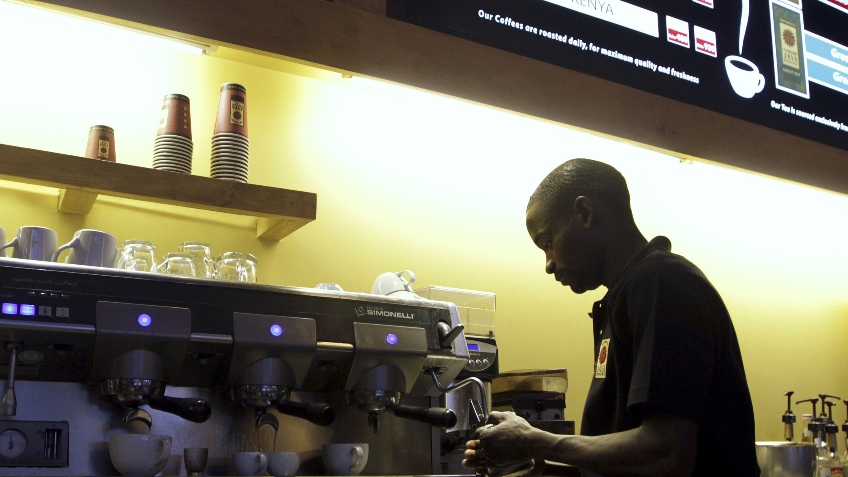 A worker prepares coffee at a Nairobi Java House outlet.