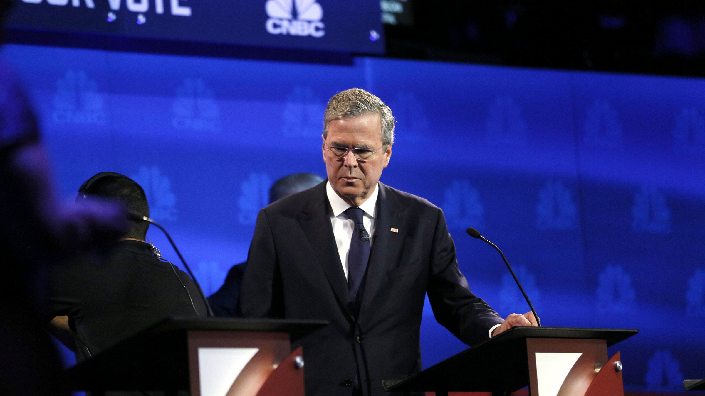 Republican U.S. presidential candidate and former Florida Governor Jeb Bush pauses at his podium in the midst of a commercial break at the 2016 U.S. Republican presidential candidates debate held by CNBC in Boulder, Colorado, October 28, 2015.