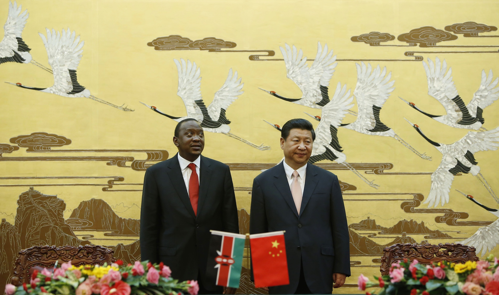 Kenyan President Uhuru Kenyatta (L ) and his Chinese counterpart Xi Jinping stand together during a signing ceremony at the Great Hall of the People in Beijing in 2013.