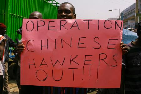 A Kenyan trader holds up a placard during a protest against Chinese hawkers in Nairobi in 2012.