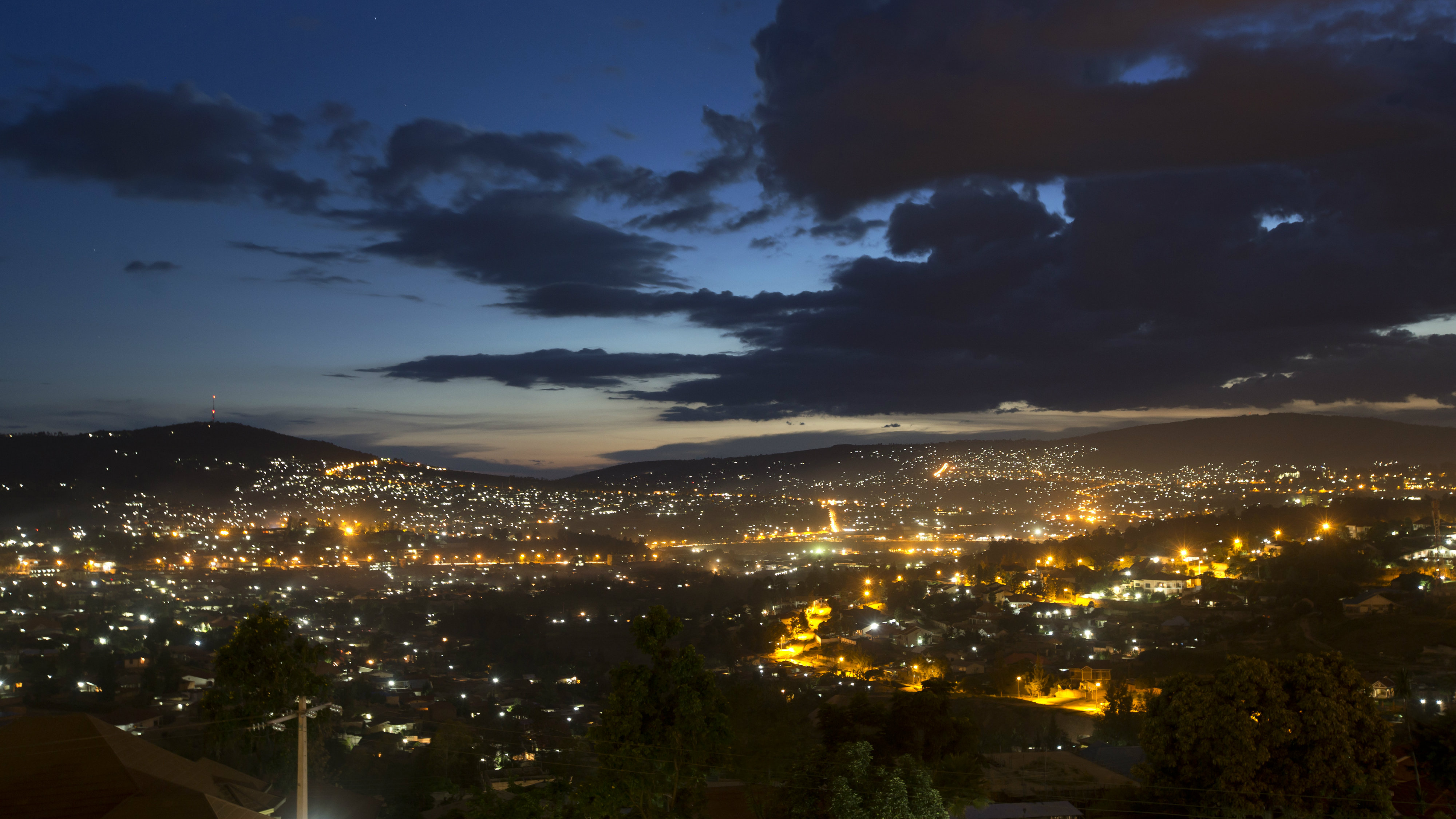 A view over the city at night in the capital Kigali, Rwanda Thursday, April 3, 2014. (AP Photo/Ben Curtis)