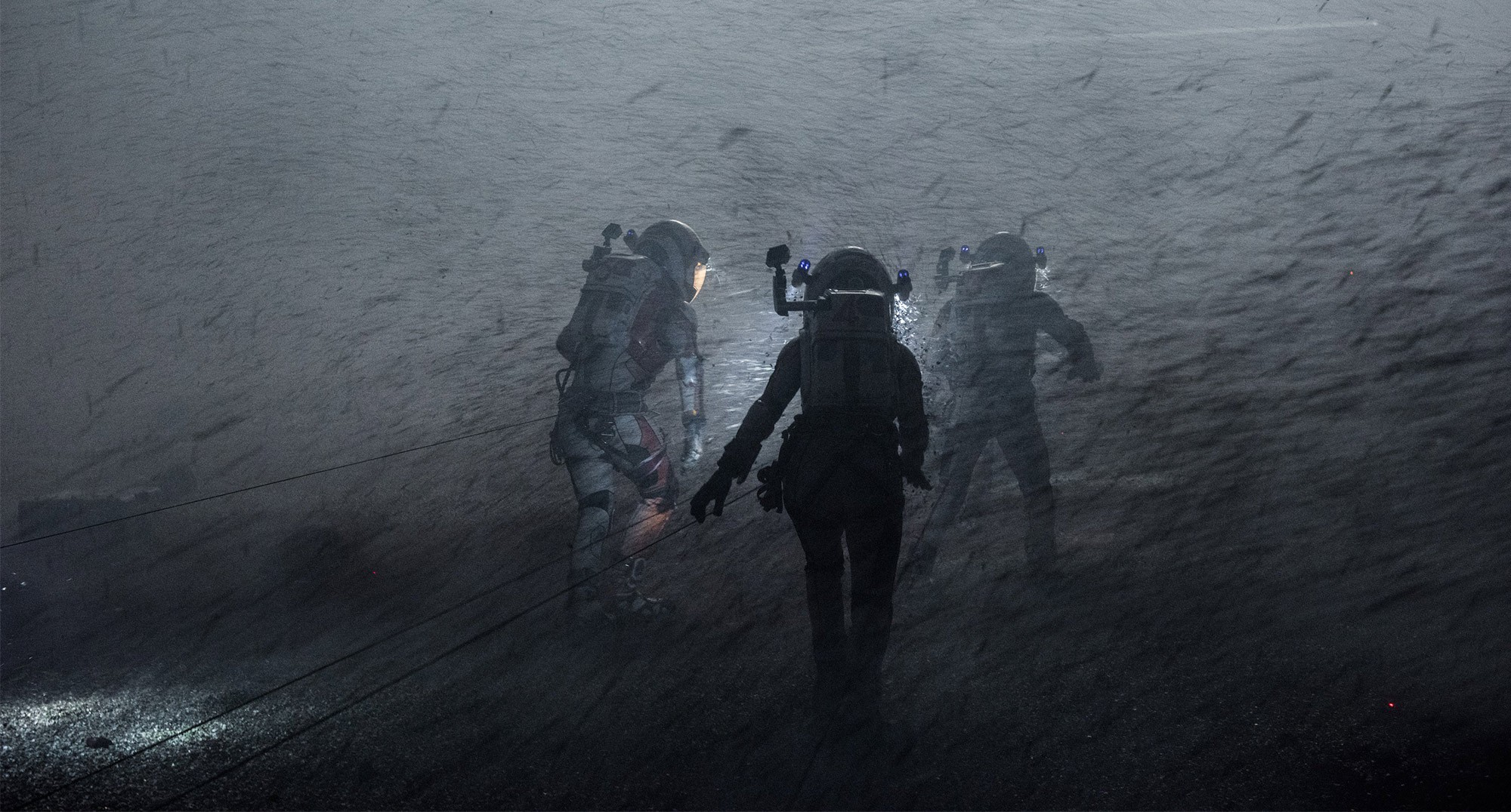 "Astronauts in a duststorm in a scene from ""The Martian"""