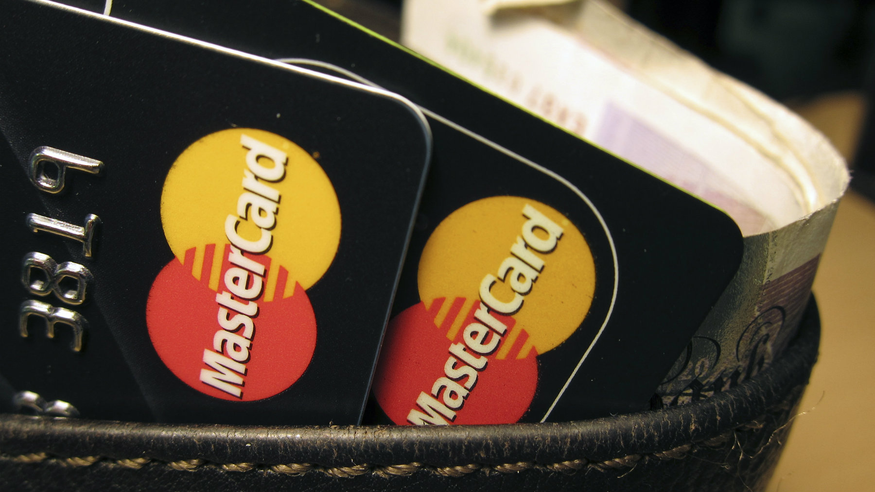 MasterCard credit cards are seen in this illustrative photograph taken in London December 8, 2010. Hackers have crashed the website of credit card firm MasterCard in apparent retaliation for its blocking of donations to the Wikileaks website it was reported on Wednesday. REUTERS/Jonathan Bainbridge