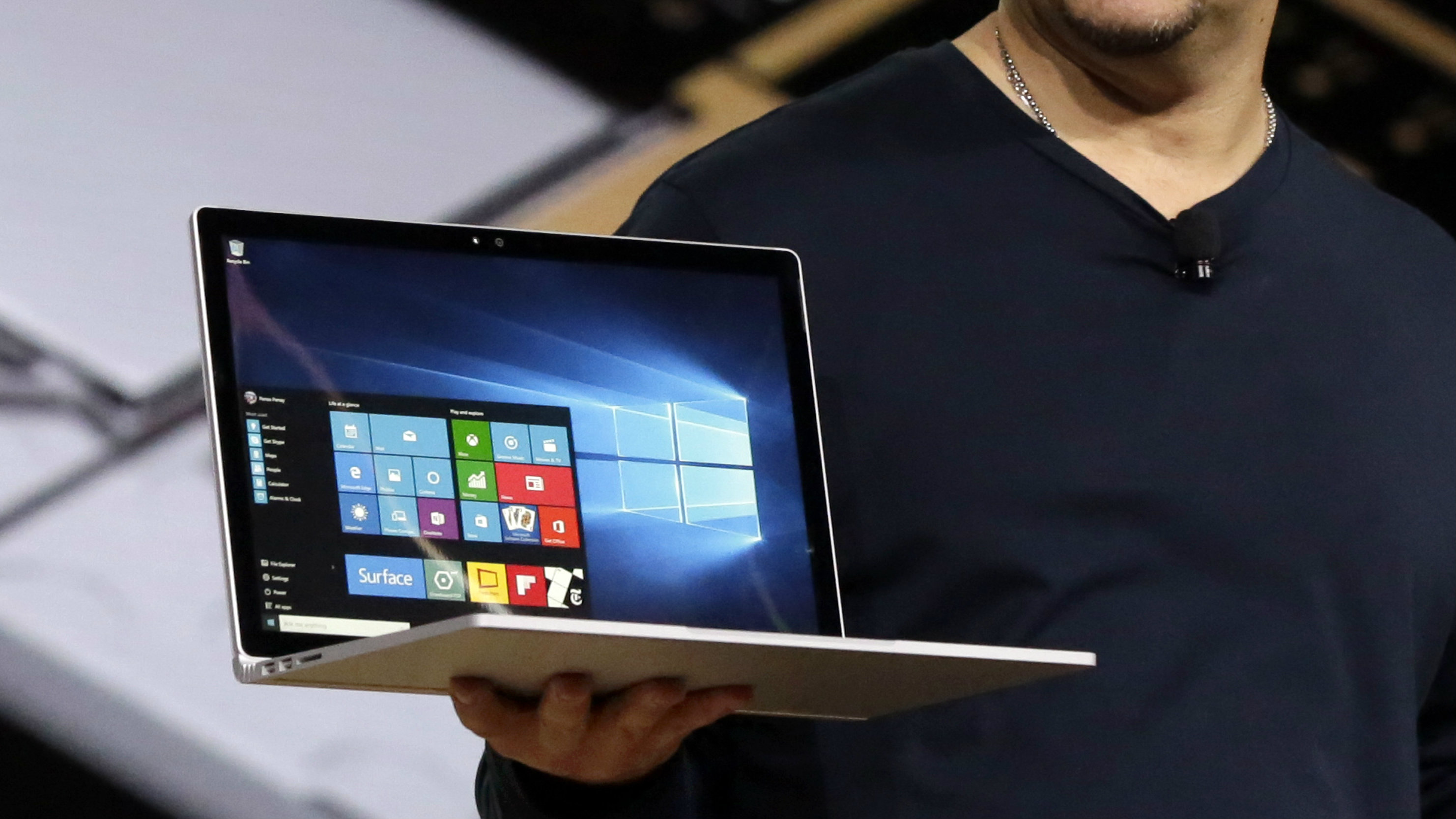 Microsoft vice president for Surface Computing Panos Panay holds a Surface Book laptop during a presentation, in New York, Tuesday, Oct. 6, 2015. Microsoft says it's for scientists, engineers and gamers who need a lot more performance than a tablet. (AP Photo/Richard Drew)