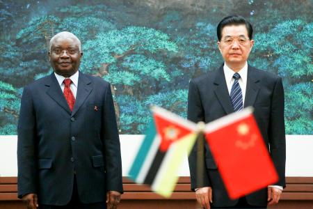 Mozambique's former president Armando Guebuza (L) stands next to China's former leader Hu Jintao during a signing ceremony at the Great Hall of the People in Beijing.