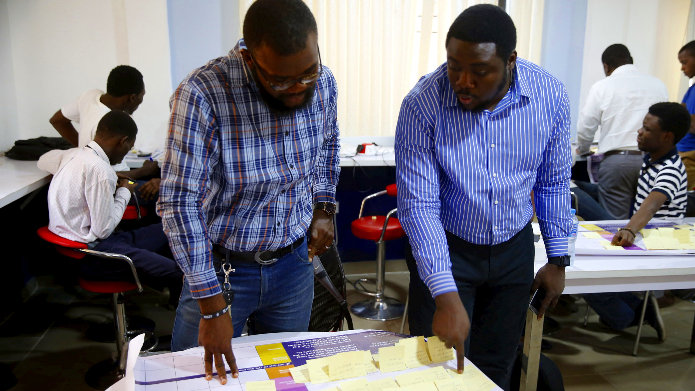 Software developers work at the Information Technology Developers Entrepreneurship Accelerator (iDEA) hub in the Yaba district in Lagos June 25, 2015. At first glance, Yaba is like many other parts of Nigeria's sprawling commercial capital: a cacophony of car horns and shouting street vendors, mingling with exhaust fumes and the occasional stench of sewage. But in between the run-down buildings in this seemingly inauspicious part of Lagos, a city of around 21 million, tech start-ups are taking root and creating a buzz that is drawing international venture capitalists and more established digital firms. Picture taken June 25, 2015.