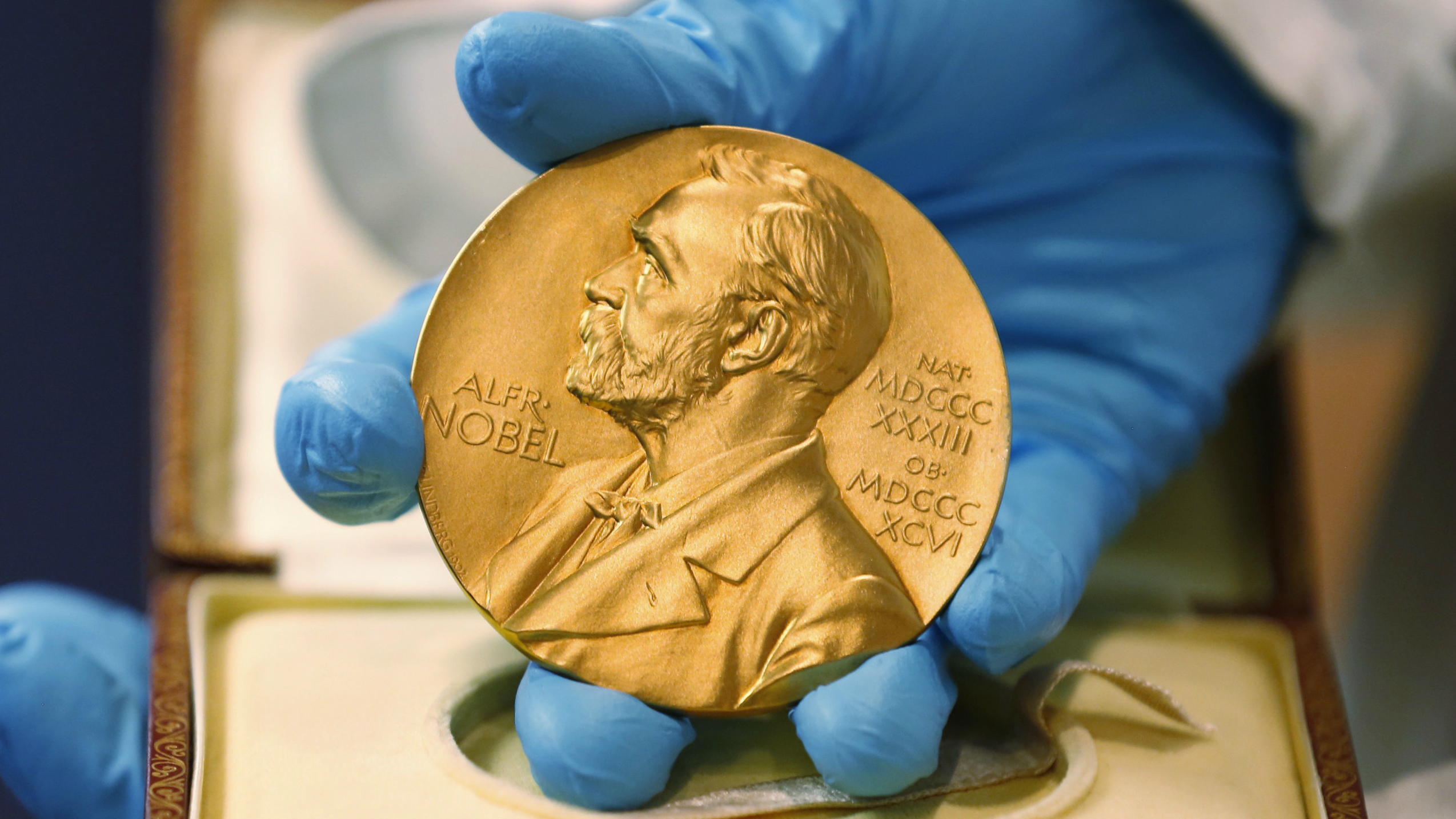 LE- In this file photo dated Friday, April 17, 2015, A national libray employee shows the gold Nobel Prize medal awarded to the late novelist Gabriel Garcia Marquez, in Bogota, Colombia. The beginning of October 2015 means Nobel Prize time, when committees in Stockholm and Oslo announce the winners of what many consider the most prestigious awards in the world, each worth some 8 million Swedish kronor (US dlrs 960,000) presented to the worthy recipients with a diploma and a gold medal. (AP Photo/Fernando Vergara