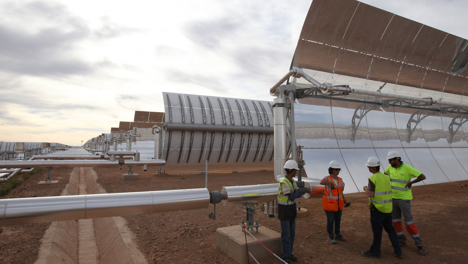 Workers at the building site of Morocco's Noor I solar power plant