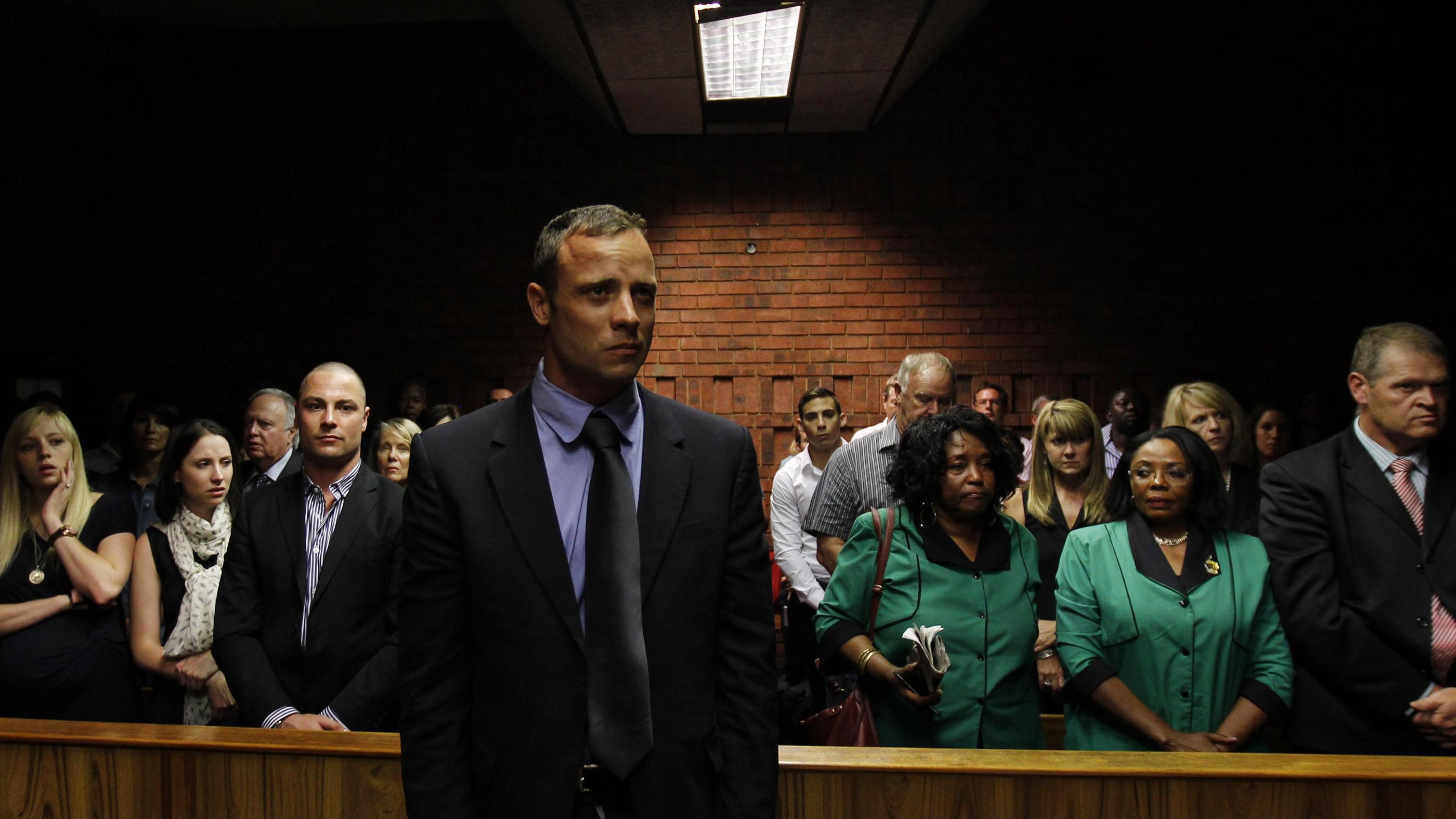 Oscar Pistorius awaits the start of court proceedings in the Pretoria Magistrates court.