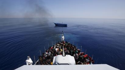 Migrants rescued from a tiny boat