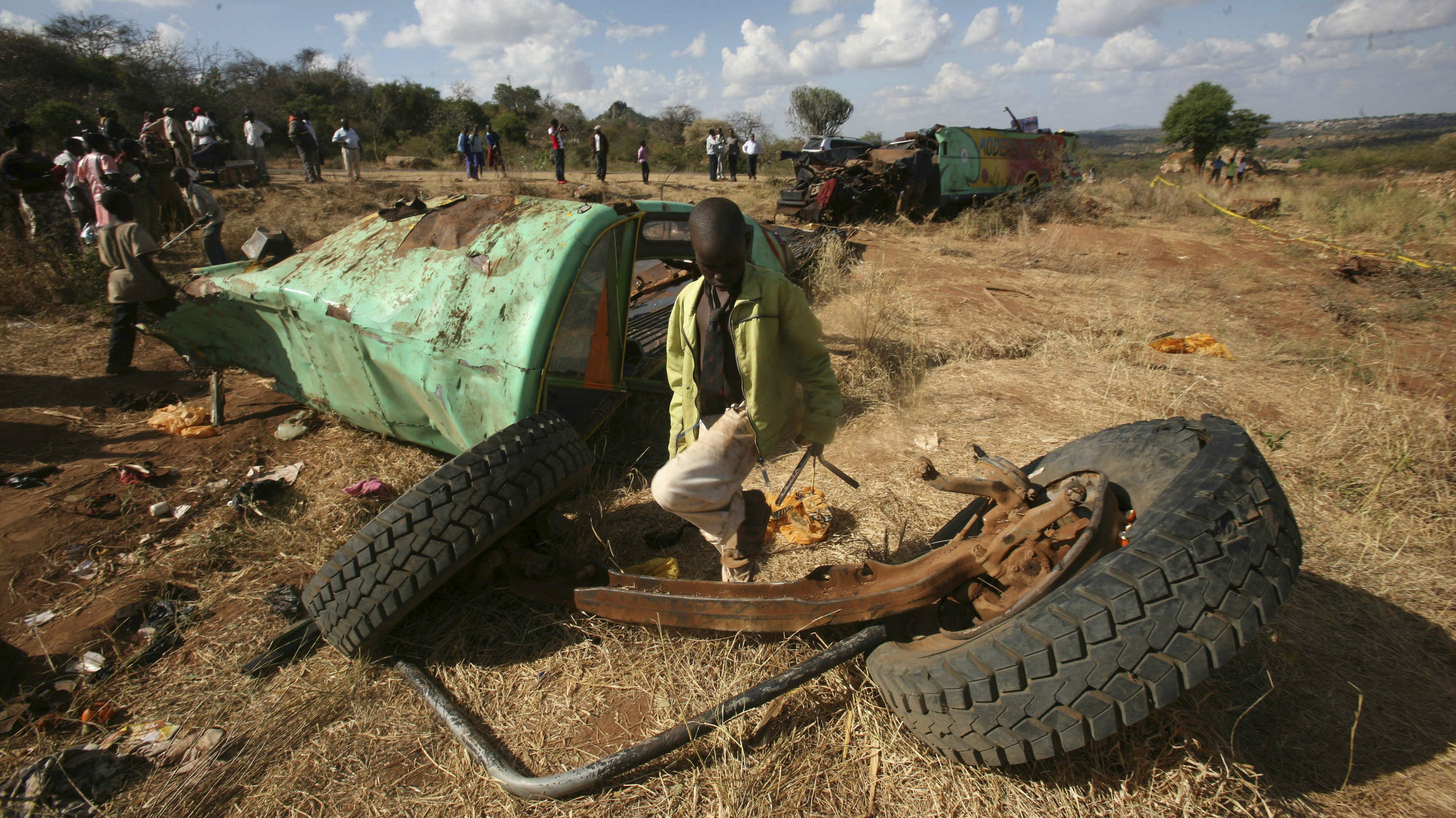 A boy walks at the scene of a passenger bus accident near Mwingi town in eastern Kenya February 27, 2013. At least 35 people were killed in the grisly road accident early Wednesday morning when the Garissa-bound bus lost control and rolled several times in Tulimani area, according to Traffic Commandant Samuel Kimaru. REUTERS/Gregory Olando