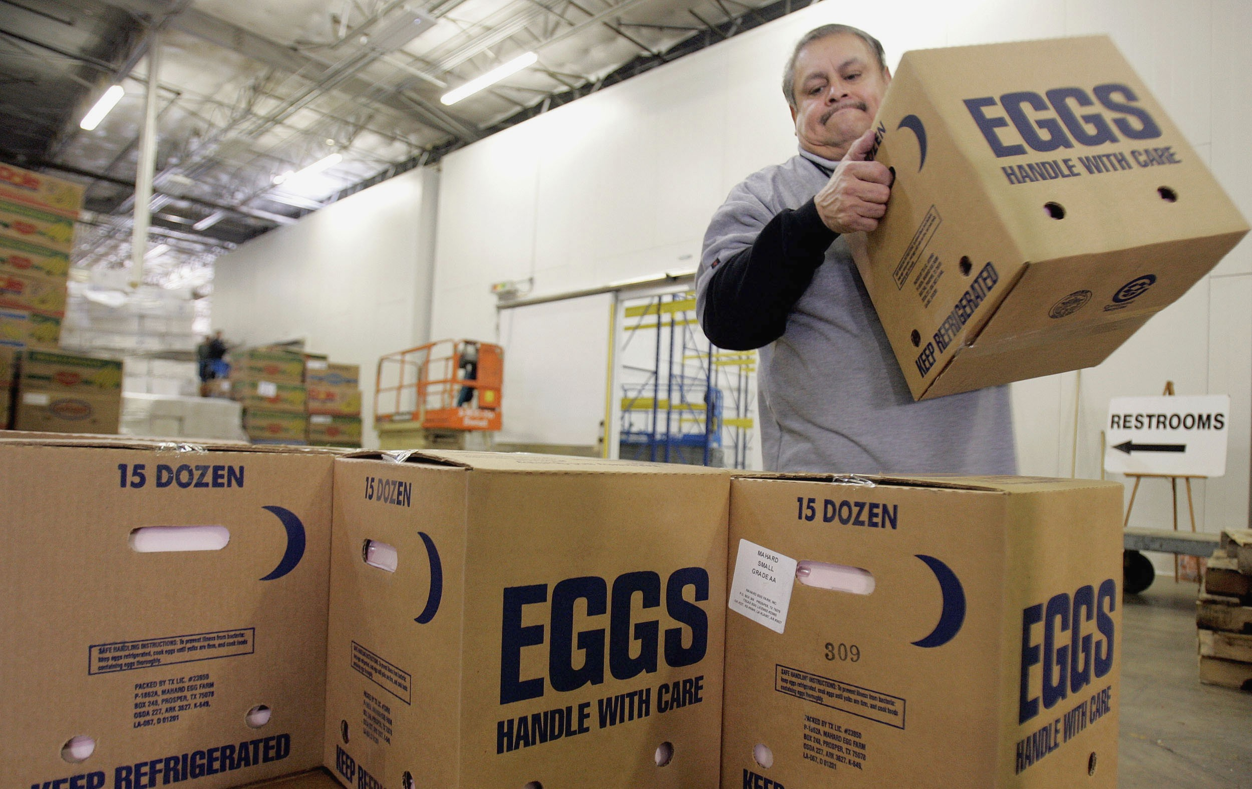 A worker at the North Texas Foodbank stacks boxes of eggs to be loaded into trucks and delivered to various soup kitchens and food distribution centers in Dallas, Texas November 20, 2006