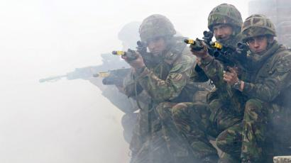 Soldiers from the British Royal Marines Commando demonstrate city fighting techniques.